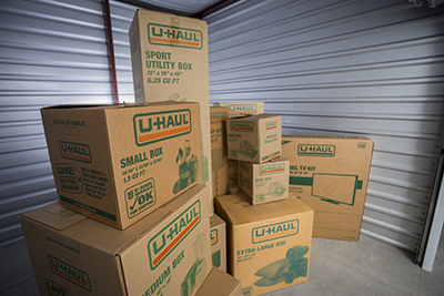 Stacked moving boxes of varying sizes in a storage unit at Citywide Storage in Salina, KS.